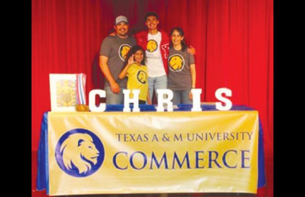 RHS senior Chris Flores signs